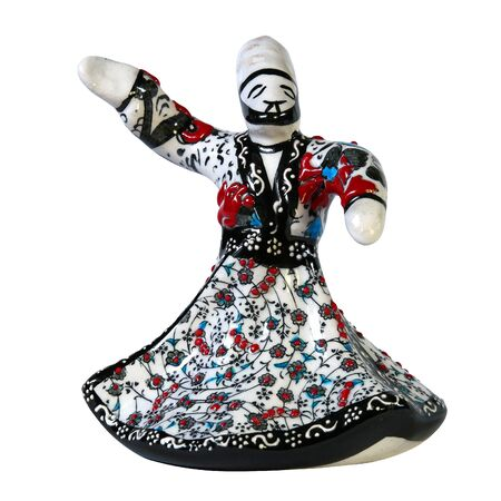 whirling: Saint-Petersburg, Russia - April 26, 2016: Ceramic figurine of a dancing dervish. The figure clearly made up. Isolated object. Front view. Editorial