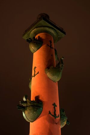 earlier: St. Petersburg. South rostral column. Top part. Night Photography. Earlier rostral column represented the Navy and served as a beacon of glory. Stock Photo