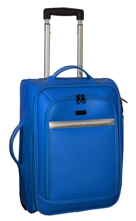 pushed: Suitcase for travel. Blue color with silver accents. Extendable handle pushed half. Stock Photo
