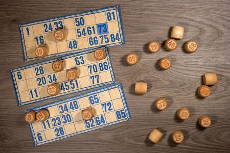 lotto: Vintage lotto: kegs and cards. Placed on a wooden countertop.