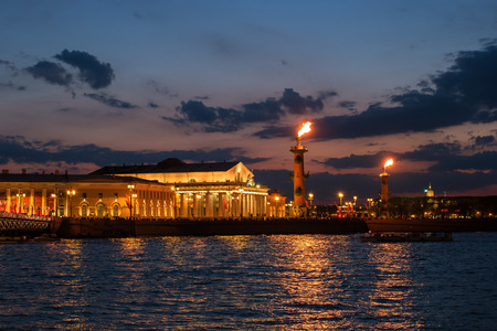 ignited: Night view of the rostral columns, Exchange Building, Neva from the Palace Embankment. In the rostral column ignited gas flares. St. Petersburg, Russia