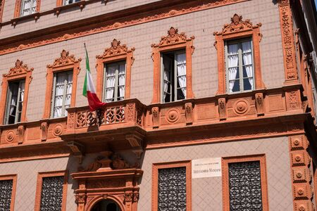 second floor: Milan, Italy - May 25, 2016: Italian writer Alessandro Manzoni house. The windows of the second floor.