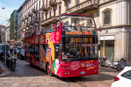 open topped: Milan, Italy - May 25, 2016: People go on the red bus and see the sights. These tour buses are very popular among tourists. Editorial