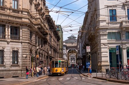 vittorio emanuele: Milan, Italy - May 25, 2016: View of the Galleria Vittorio Emanuele II by Piazza Cordusio. In the foreground the yellow tram and urban people at a tram stop. Editorial