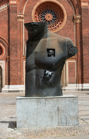 igor: Milan, Italy - May 25, 2016: Sculpture of Polish sculptor Igor Mitoraj in Piazza del Carmine. His works adorn the most famous cities in the world.