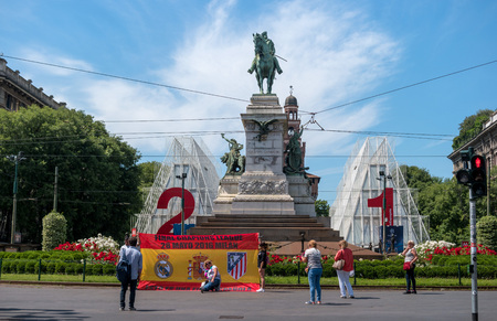 Milan, Italy - May 25, 2016: Bronze monument to Giuseppe Garibaldi in Piazzale Carioli -Piazza Castello- in Milan was modelled in 1895 by Ettore Ximenes. Soccer fans came to the Champions League final.