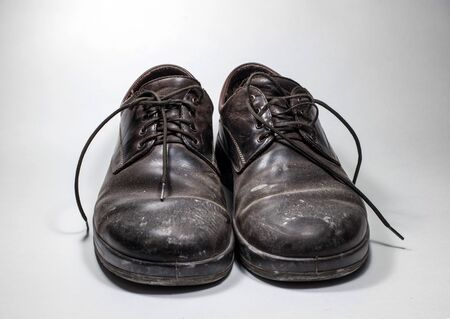 whitewash: Dirty mens shoes sprinkled with whitewash. Shoes on a white background.