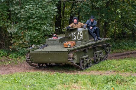 lightweight: Gatchina, Russia - September 11, 2016: The historical reconstruction of World War II. Lightweight floating tank T-37A. Tank returns from exploration. On the armor is a military korresondent. Editorial