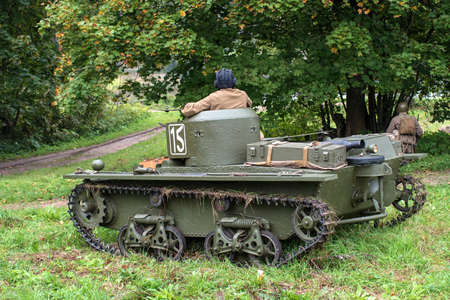 lightweight: Gatchina, Russia - September 11, 2016: The historical reconstruction of World War II. Lightweight floating tank T-37A. The tank is in wait, guarding infantry.