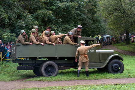 Gatchina, Russia - September 11, 2016: The historical reconstruction of World War II. Truck ZIS-5 - one of the main transport vehicle of the Red Army during the Great Patriotic War. Truck transporting soldiers.