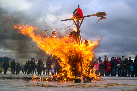 almost all: Saint-Petersburg, Russia - February 22, 2015: Feast Maslenitsa on Vasilyevsky Island. Burning doll - a doll almost all burned, and there was one skeleton. Editorial