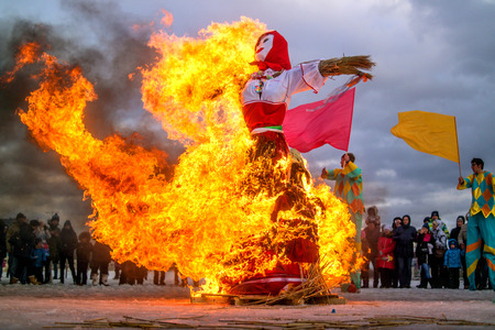 Saint-Petersburg, Russia - February 22, 2015: Feast Maslenitsa on Vasilyevsky Island. Burning doll - a doll almost all burned, and there was one skeleton. Editorial