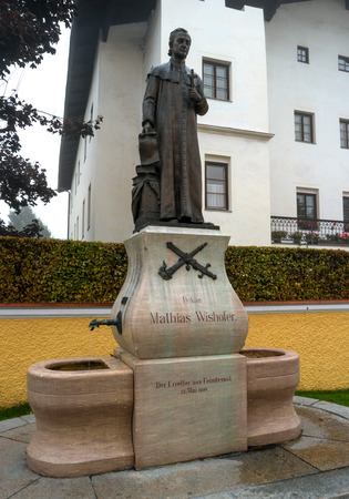 revolt: St. Johann, Austria - October 13, 2016: Monument to the dean of the church from 1784 to 1819 Mathias Wishofer. In 1809, Mathias Wishofer saved the city from destruction by the French.