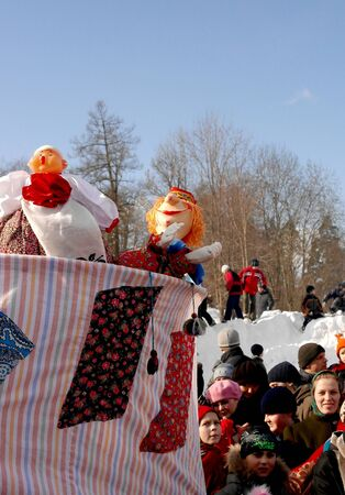 Gatchina, Leningrad region, Russia - March 5, 2011: Maslenitsa. a traditional spring holiday at the Russian peoples. The old puppet theater with the main character - Petrushka.