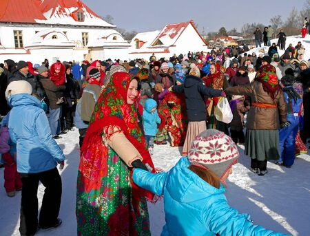 Gatchina, Leningrad region, Russia - March 5, 2011: Maslenitsa. a traditional spring holiday at the Russian peoples. Artists with the audience dance in a circle. Editorial
