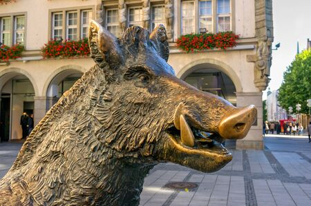 st german: Munich, Germany - October 16, 2011: Statue bronze boar. It is located directly opposite the German Museum of hunting and fishing, which once housed the Church of St. Augustine.