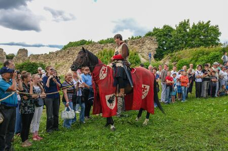 knightly: Koporje, Leningrad region, Russia - July 21, 2012: Reconstruction of knightly duels and battle chivalrous life camp, tents. Equestrian Knight welcomes visitors.