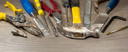 old tools: Old tools on wooden background.