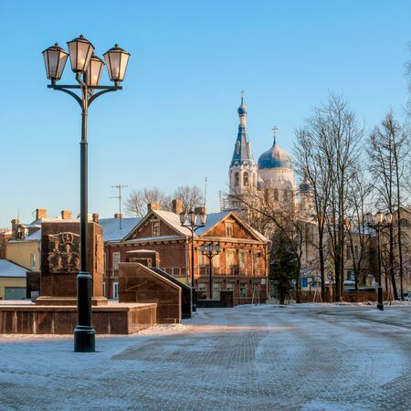 Gatchina, Russia - a view of the Pokrovsky Cathedral, left a fragment of the monument to the -City of Military Glory-, a wooden house is on the street Chkalov. Stock Photo