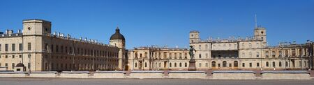 Gatchina Palace. Russia. Panoramic view of the Palace Square and the main entrance and the left wing of the palace with a watchtower. Stock Photo