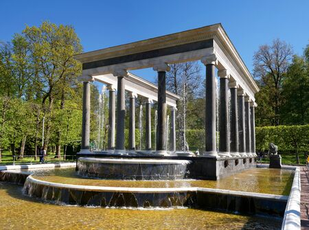 The Lion Cascade fountain. Another name is the Hermitage. It is a pool with waterfall ledges of pudost stone, decorated with two bronze sculptures of guard lions. Peterhof, Russia. Stock Photo
