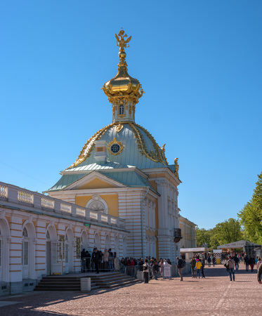 double headed: Peterhof, Russia - June 5, 2017: The building is a special pantry. The baroque dome is decorated with a double-headed eagle. People go on an excursion. Editorial