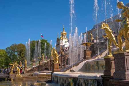 Great cascade. It consists of many fountains and is decorated with bronze gilt sculptures. During the holidays, it becomes a stage for costumed performances. Peterhof, St. Petersburg, Russia.