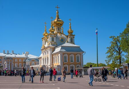 Peterhof, Russia - June 5, 2017: Church of Peter and Paul. The Palace Church. The domes are gilded and richly decorated. View of the church from the side of the Palace Square.