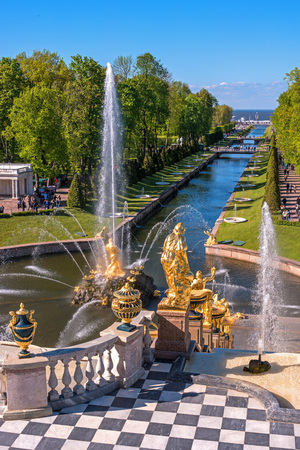 Peterhof, Russia - June 5, 2017: The Grand Cascade and Samson Fountain at the Grand Peterhof Palace. These palaces and gardens are sometimes referred as the -Russian Versailles-. Background: The Sea Canal.