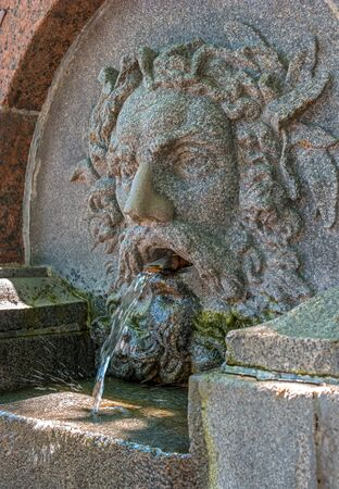 Saint Petersburg, Russia - June 17, 2017: Fountain in Voronikhin Park near the Kazan Cathedral. In the photo there is a fragment of a fountain. Saint-Petersburg, Russia Editorial