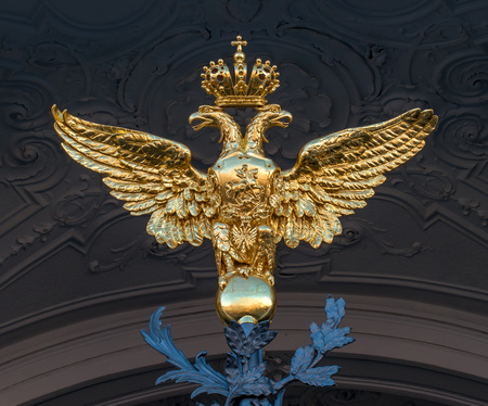 Saint Petersburg, Russia - July 30, 2017: Golden two-headed eagle on the gates of the State Hermitage Museum.