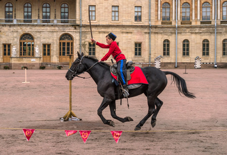 Gatchina, St. Petersburg, Russia - September 30, 2017: Horse show of Cossacks on the parade ground of the Gatchina Palace on the day of the anniversary of Emperor Paul I. Editöryel