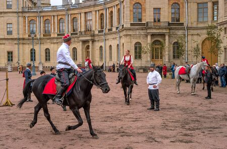 Gatchina, St. Petersburg, Russia - September 30, 2017: Horse show of Cossacks on the parade ground of the Gatchina Palace. Cossacks artists are preparing for the tricks.