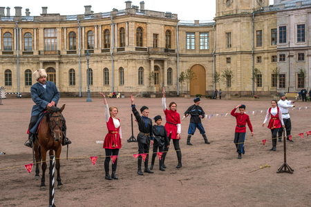 Gatchina, St. Petersburg, Russia - September 30, 2017: Horse show of Cossacks on the parade ground of the Gatchina Palace. Young Cossacks greet the audience after the performance.