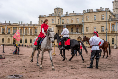 cossacks: Gatchina, St. Petersburg, Russia - September 30, 2017: Horse show of Cossacks on the parade ground of the Gatchina Palace. Cossacks artists are preparing for the tricks.