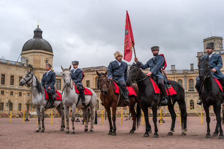 Gatchina, St. Petersburg, Russia - September 30, 2017: Horse show of Cossacks on the parade ground of the Gatchina Palace. The construction of Cossacks on the parade ground of the Gatchina Palace.