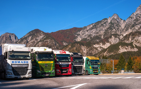 semitruck: TYROL, AUSTRIA - October 14, 2017: Trucks parked in a parking lot in the Alps.