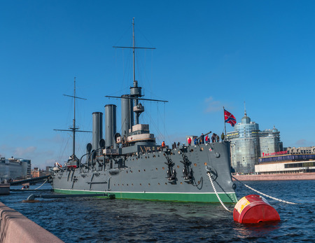 Saint Petersburg, Russia-April 28, 2018: The Cruiser Aurora. The ship is moored at Petrogradskaya embankment and is a Museum. On the nose set naval flag of Russia.