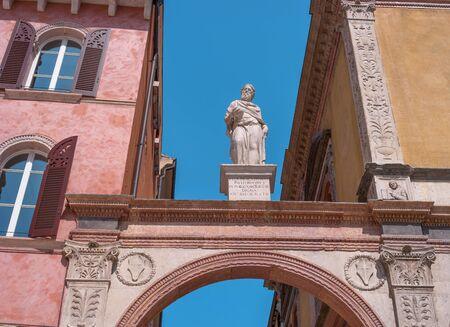 Verona, Italy - 06 May 2018: Statue of Pavlli Filippi over the arch between Casa della Pieta and Loggia del Consiglio in Verona, Italy
