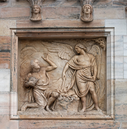 Architectural fragment of the Milan Duomo Cathedral. The cathedral was built in the Gothic and Romanesque styles. Milan, Italy, Lombardy