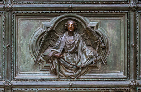 Detail of the Pieta scene in bas-relief at Milans Cathedral doors