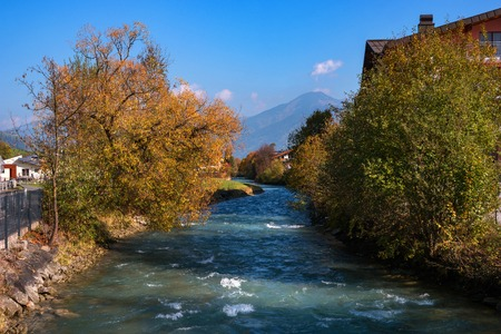 Autumn season. Beautiful view of the Austrian Alps with colorful nature, trees, leaves and a stream in Kaprun, Austria. Kaprun is located near the town of Zell am see.