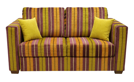 Colorful striped sofa isolated on white background. On the couch yellow decorative pillows. Full face Imagens