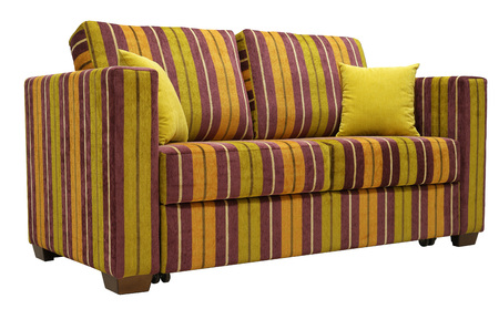 Colorful striped sofa isolated on white background. On the couch yellow decorative pillows. Low angle Imagens