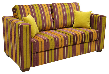 Colorful striped sofa isolated on white background. On the couch yellow decorative pillows. High angle
