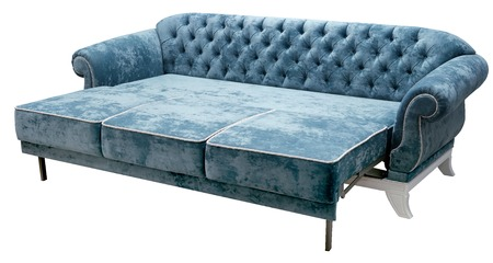 Classic sofa isolated on white background. The back of the sofa is decorated with a carriage fastener. Elegant white base. Imagens