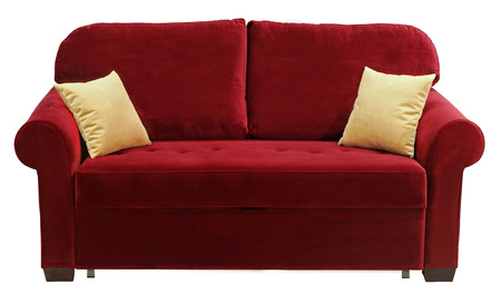 Red sofa isolated on white background. On the couch yellow decorative pillows Imagens