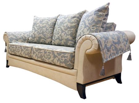 Elegant sofa isolated on white background. On podlakoniki capes with decorative tassels.
