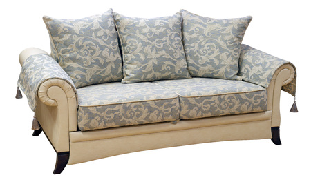 Elegant sofa isolated on white background. On  capes with decorative tassels. Including clipping path Imagens