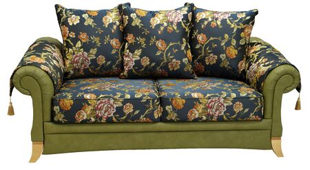 Elegant sofa isolated on white background. On the armrests capes with decorative tassels. Imagens